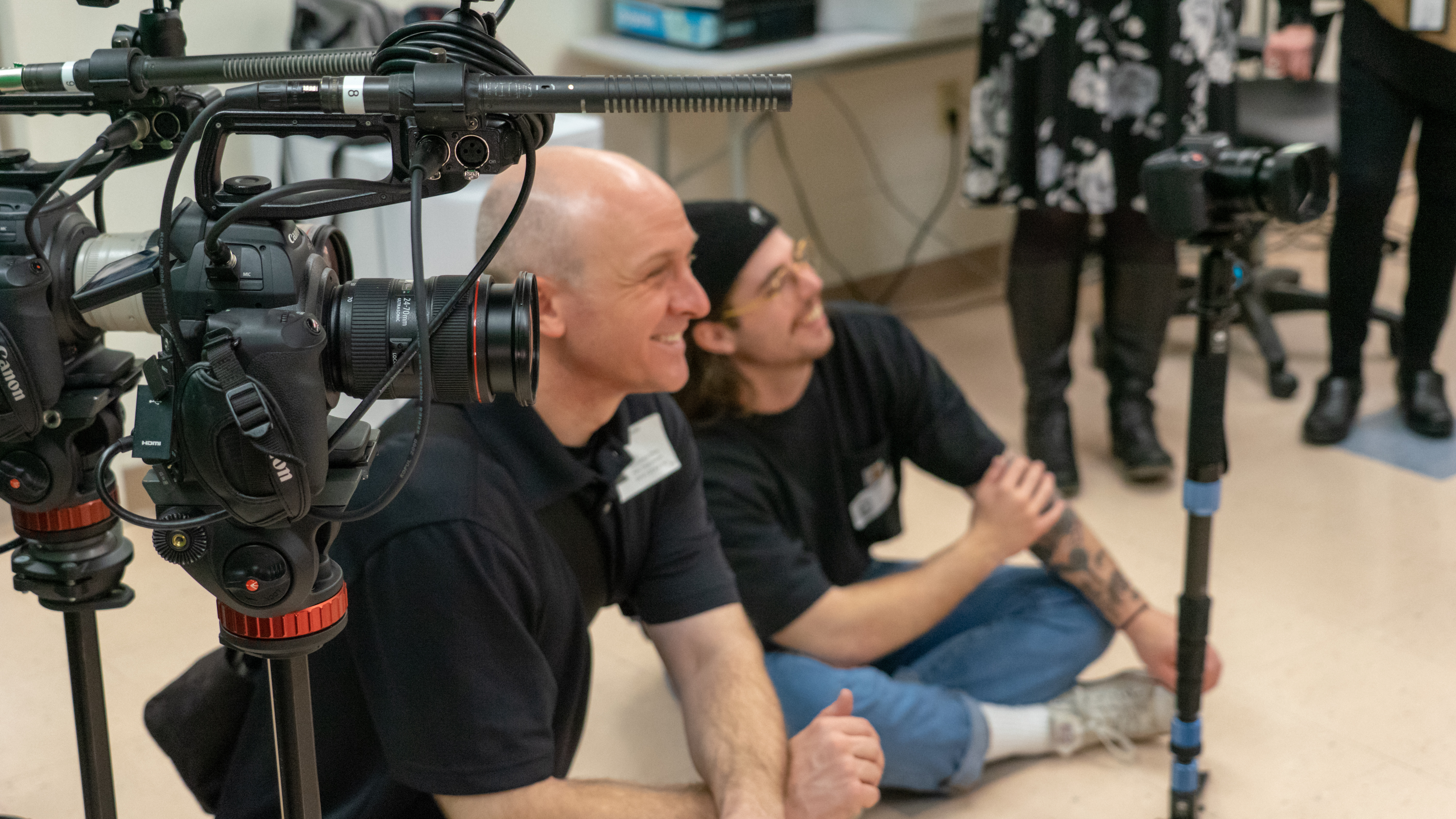 Paul Wasneski and Peter Straehl need to juggle multiple aspects of video production when filming, including monitoring cameras and simultaneously conducting interviews.