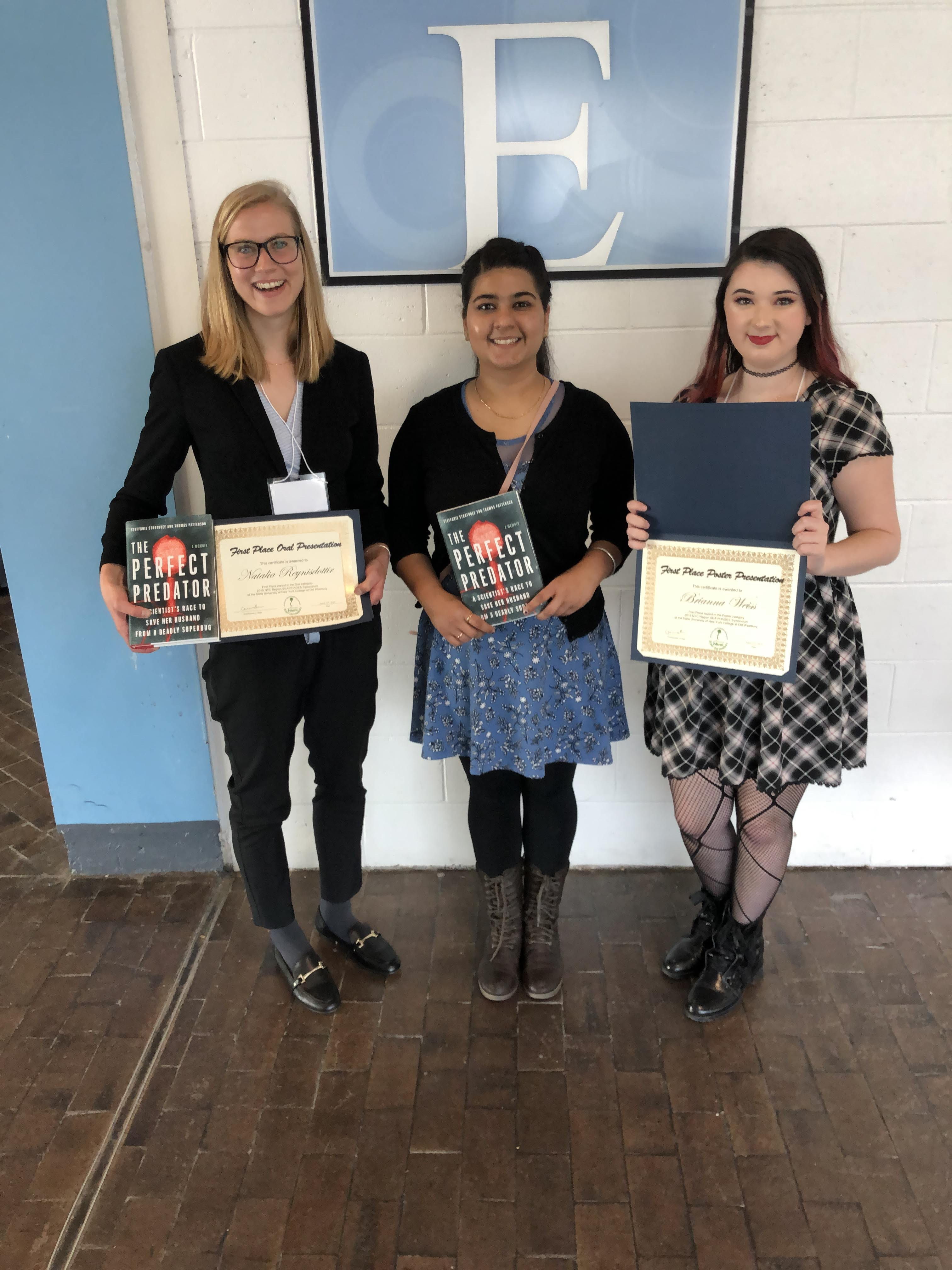 NYIT Life Science students, Natalia Reynisdottir, Lovejit Kaur and Brianna Weiss with their awards