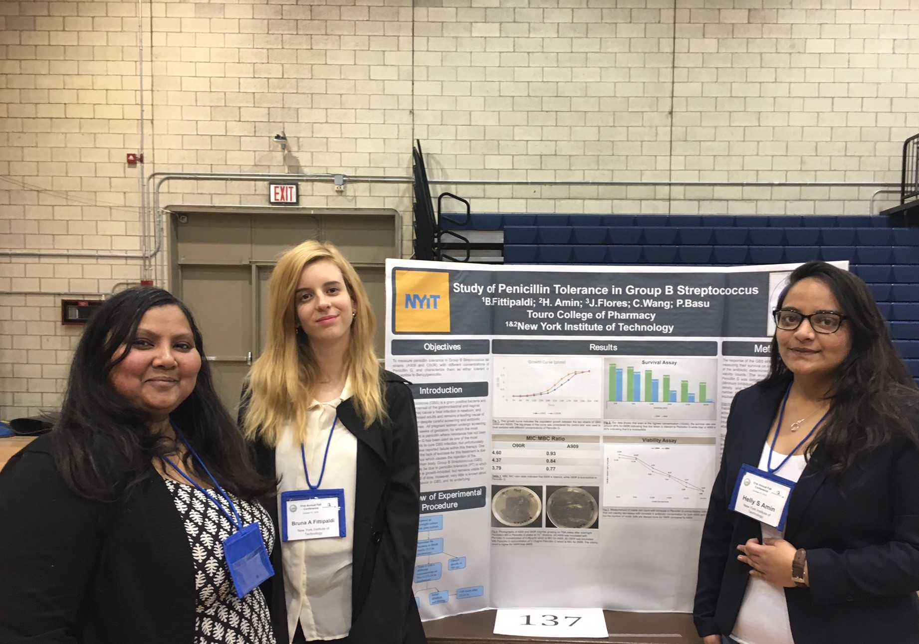 Bruna Fittipaldi and Helly Amin with mentor Dr. Paramita Basu-Mukherjee present their poster at MACUB 2018