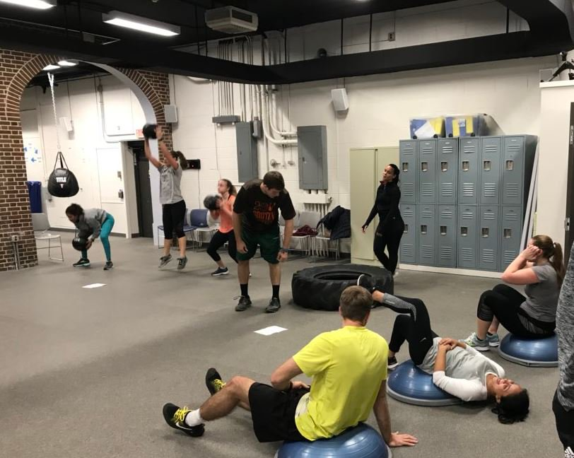 Medical students engaging in fitness activities in the NYIT Wellness Gym